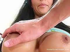 Big tit brunette sucks a fat cock