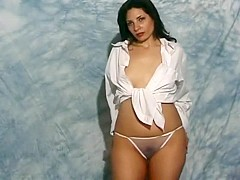 Lorena does some sexy posing in her white shirt and see through panties