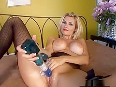 Blonde bombshell with a sweet ass pleasures herself with a toy