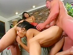 Two feisty babes get nasty with two big dicks in a wild group session