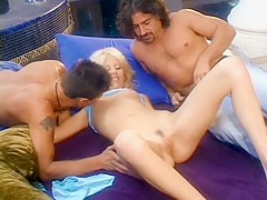Trampy blonde babe with perky tits gets plowed by two big cocks