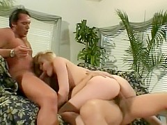 Jordan reaches the summit of her climax as two big dicks bang her holes at the same time