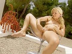 Sensual blonde temptress hangs out in the sun for a hot masturbation session with her pink rabbit