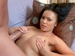 Exotic beauty with big tits milks a dick all over her big tits