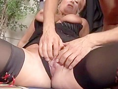 Mature bitch with gigantic tits takes it deep from a young man