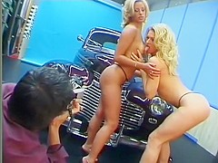 Hot blondes with gorgeous tans get fucked on top of a classic car
