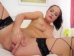 Uninhibited brunette Dolly enjoys fisting her own twat for the camera