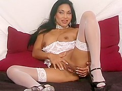Sensual Tina Toy puts on her sexy white lingerie and displays her body