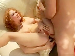Trashy redhead cougar with big boobs engages in rough anal sex outside
