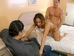 Pretty brunette sucks a long dick and gets fucked hard in front of her husband