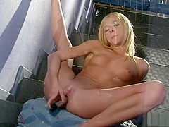 Alluring blonde with a hot body takes to the basement for a tryst with a dildo