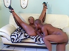 A feisty black slut gets on all fours to be screwed like a dog