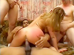 Cleanly shaved blonde takes two big dicks to a terrific sexual session