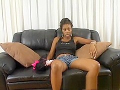 Slutty black girl in pink fishnets enjoys a hard pounding on the couch