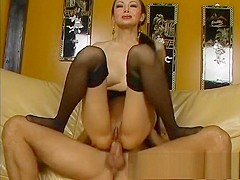 Busty Asian mom in black stockings takes a long cock deep in her butt