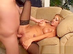 Wild blonde bombshell in black stockings reveals her love for anal sex