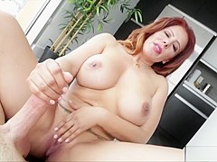 Stunning redhead milf with big hooters blows and strokes a long dick