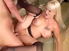 Busty blonde in stockings has sex with a stranger in front of her man