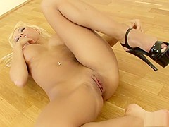 Stacked blonde beauty with a superb ass has a passion for high heels