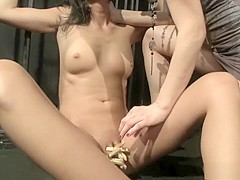 Tanned brunette gets fucked with a dildo in this hot girl-on-girl action
