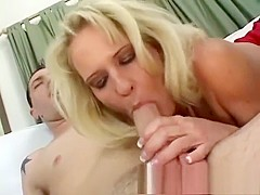 Stunning blonde milf with big boobs has steamy sex with a younger guy