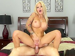 Ravishing blonde milf with big round boobs Helly fucks a young stud