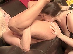 Busty blonde MILF gets her world rocked by a fat brunette bitch