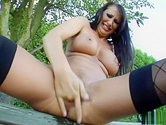 Voluptuous brunette cougar Mandy fucks her tight cunt with a big dildo