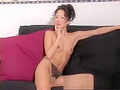 Seductive Oriental milf Tiffany peels off her underwear for the camera