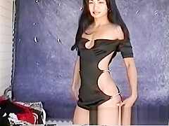 Janice tries on different clothes while posing and showing her nice butt