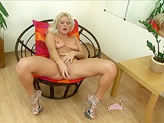 Sexy blonde Kathy Anderson changes up dildos when fucking herself