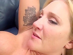 Charming blonde with big hooters Alexis fucks a long pole on the couch