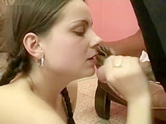 Dark haired beauty gets cum in her mouth and she loves it