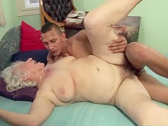 Naughty old lady goes crazy for a young stud's large dick on the bed