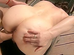Irresistible GILF gets a sensual massage and fucks a young dude