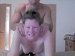 Swinger whore fucked by stranger while sucking hubby's cock