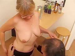 blonde granny with glasses gets fucked on a chair