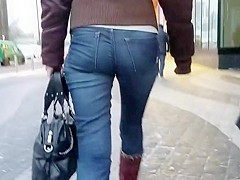 Ass in blue jeans go to the office