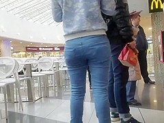Sweet brunette with ass in tight jeans