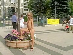 Hot blonde photographing on the street naked