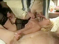 Mature swinger wives getting gangbanged by strangers at an interracial sex party