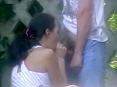 Slutty amateur brunette giving her man an incredible blowjob downtown