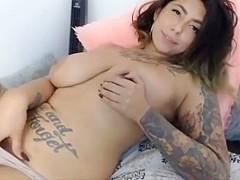 Big girl with huge tits and tattoo masturbating on HotDivine