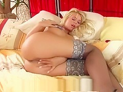 Pretty busty blonde masturbates in sheer nylon