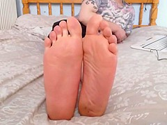 sexy feet and soles on bed