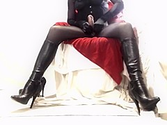 Kinky crossdresser in boots corset and seamed tights