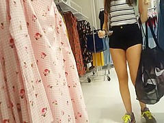 Candid voyeur teen in cheeky shorts clothes shopping