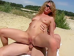 Blonde Is Sucking A Cock On The Beach