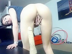 Brunette girl toying her shaved pussy