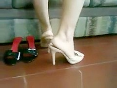 Latina Putting On Her White High Heels